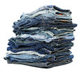 A stack of various pairs of jeans pants isolated on white background Stock Photo