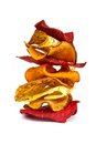 Stack of vegetable chips  on white Royalty Free Stock Photo