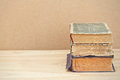 Stack of vintage books good copy space old on wooden table Stock Photos