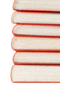 Stack of vintage books with red covers isolated on white Stock Photography