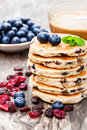 Stack  of  welsh cakes with blueberry and a cup of coffee Royalty Free Stock Photo