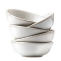 Stack of white bowls isolated on white background. Royalty Free Stock Photo