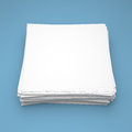 Stack of white paper on blue background Royalty Free Stock Photo