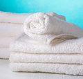 Stack of white towels spa on blue background Royalty Free Stock Image