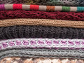 Stack of woolen clothes knitted Stock Image