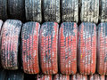 Stack of worn car tires symbol photo for safety accident risk Royalty Free Stock Photo