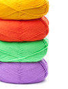 Stack of yarn skeins in red, yellow, green, purple colors Royalty Free Stock Photo