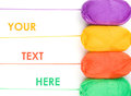 Stack of yarn skeins in yellow, orange, green, purple colors Royalty Free Stock Photo