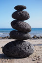 Stack of zen stones near beach tower coastline Royalty Free Stock Photos