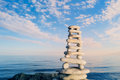 Stack zen stones sky sea background Stock Image