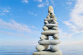 Stack of zen stones on a sky and sea background Stock Photo