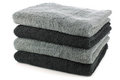 Stacked black and grey bathroom towels Royalty Free Stock Photo