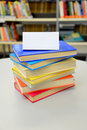 Stacked books. Books in the library. Pile of books. Colorful books. Blank card. Insert your own text. Royalty Free Stock Photo