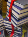 Stacked books stack of held together by a red strap Royalty Free Stock Photos