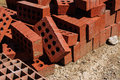Stacked bricks on a construction area under the bright sun light in building Stock Photography