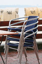 Stacked chairs on the beach a rainy day Stock Photography