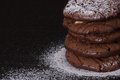 Stacked chocolate chip cookies with sugar on black Stock Photos