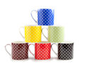 Stacked color cups colorful on white background Royalty Free Stock Photo