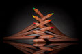 Stacked color pencils creatively of different colors with backlight Stock Photos