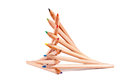 Stacked color pencils creatively of different colors on white Royalty Free Stock Photo