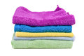 Stacked colorful towels on white background isolated Stock Images