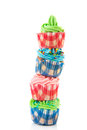 Stacked cupcakes colorful in red and blue Royalty Free Stock Photography