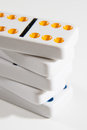 Stacked dominoes closeup bright high key photo on white of game of Stock Image