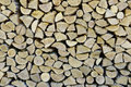 Stacked firewood closeup of chopped logs in a pile Royalty Free Stock Photos