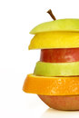 Stacked fruits sliced isolated close up Stock Photo