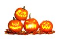 Stacked Halloween Jack o Lanterns isolated on white Royalty Free Stock Photo