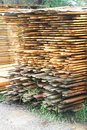 Stacked lumber pile of outdoors at construction site Royalty Free Stock Photo