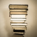 Stacked old and new books piled in a single column from smaller to larger Royalty Free Stock Photography