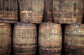 Stacked old whisky barrels pile of Royalty Free Stock Images