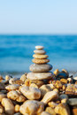 Stacked pebbles on the sea side differently sized and colored in background Royalty Free Stock Photo