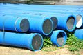Stacked pvc pipe blue on construction site Royalty Free Stock Image