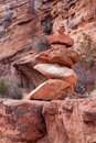 Stacked red rocks on hiking path Stock Images