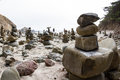 Stacked rocks left behind by people as an art form in the california coast Stock Image