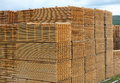 Stacked timber planks drying rough sawn for in yard Royalty Free Stock Photos