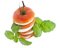 Stacked tomato mozzarella and fresh basil Royalty Free Stock Image