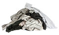Stacked used shirts isolate on white bcakground Royalty Free Stock Photos
