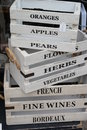 Stacked white storage boxes stack of for sale lettering fruits vegetables and wine Stock Images