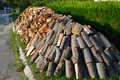 Stacked winter logs for heating Royalty Free Stock Photo