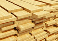Stacked wooden planks timberwork lumber work and woodwork industry concept macro view of stacks of timber Stock Image