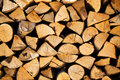 Stacked woodpile of cut and split dried logs Royalty Free Stock Photo
