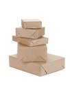Stacking parcels boxes with kraft paper isolated on white Stock Image