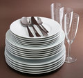 Stackof plate,cutlery and glasses Royalty Free Stock Image