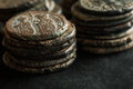 Stacks of ancient copper coins on black background Royalty Free Stock Photo