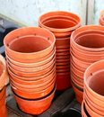 Stacks of empty plastic plant pots Royalty Free Stock Photo