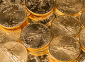 Stacks gold eagle one troy ounce golden coins us treasury mint Royalty Free Stock Photos
