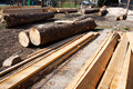Stacks of lumber for construction outdoors in different processing stages Royalty Free Stock Photo